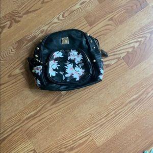 american shield mini backpack